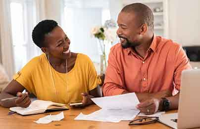 man and woman getting home improvement financing